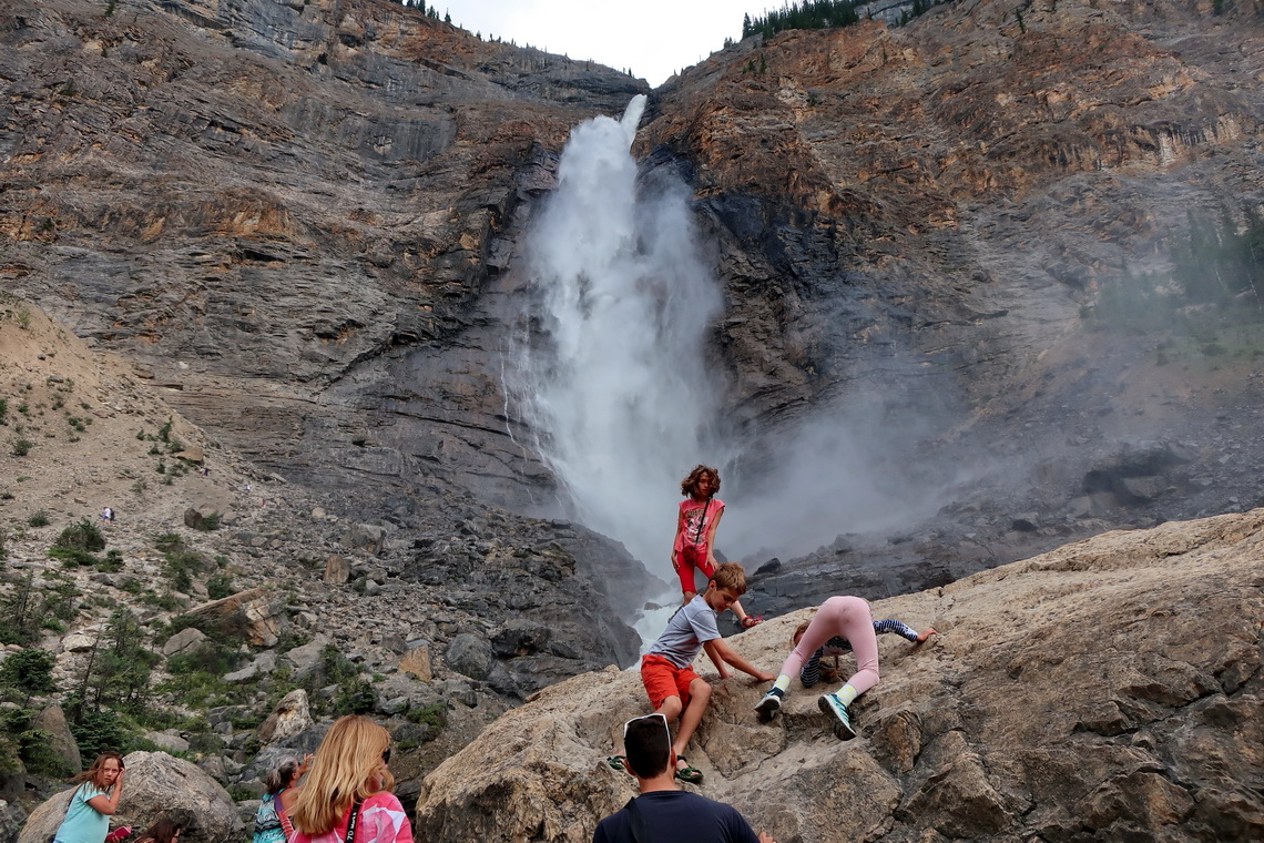 Kids including Rosemarie climbing a rock in front of the Takakkaw Falls in the Yoho National Park