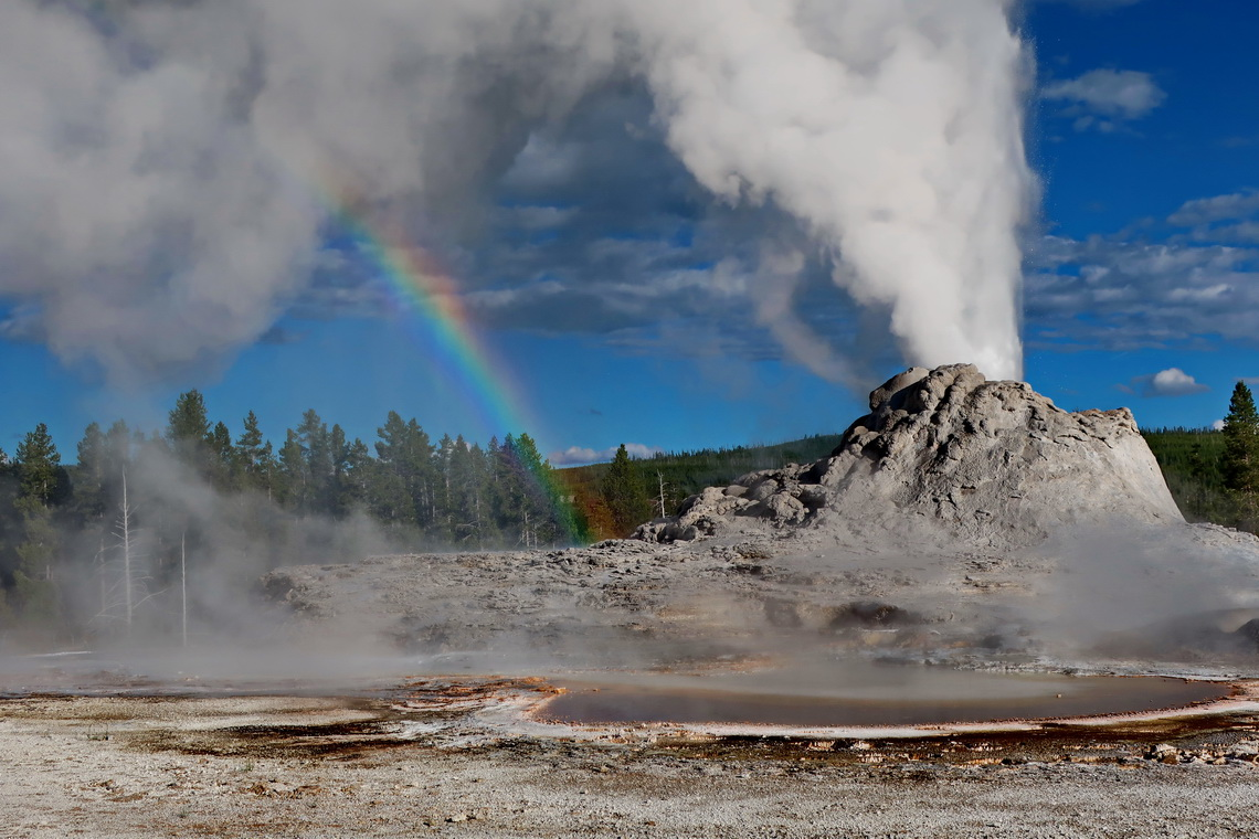 Erupting Castle Geyser with rainbow
