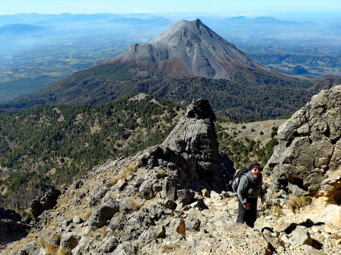 The final part to the summit of Nevado de Colima with the volcano below
