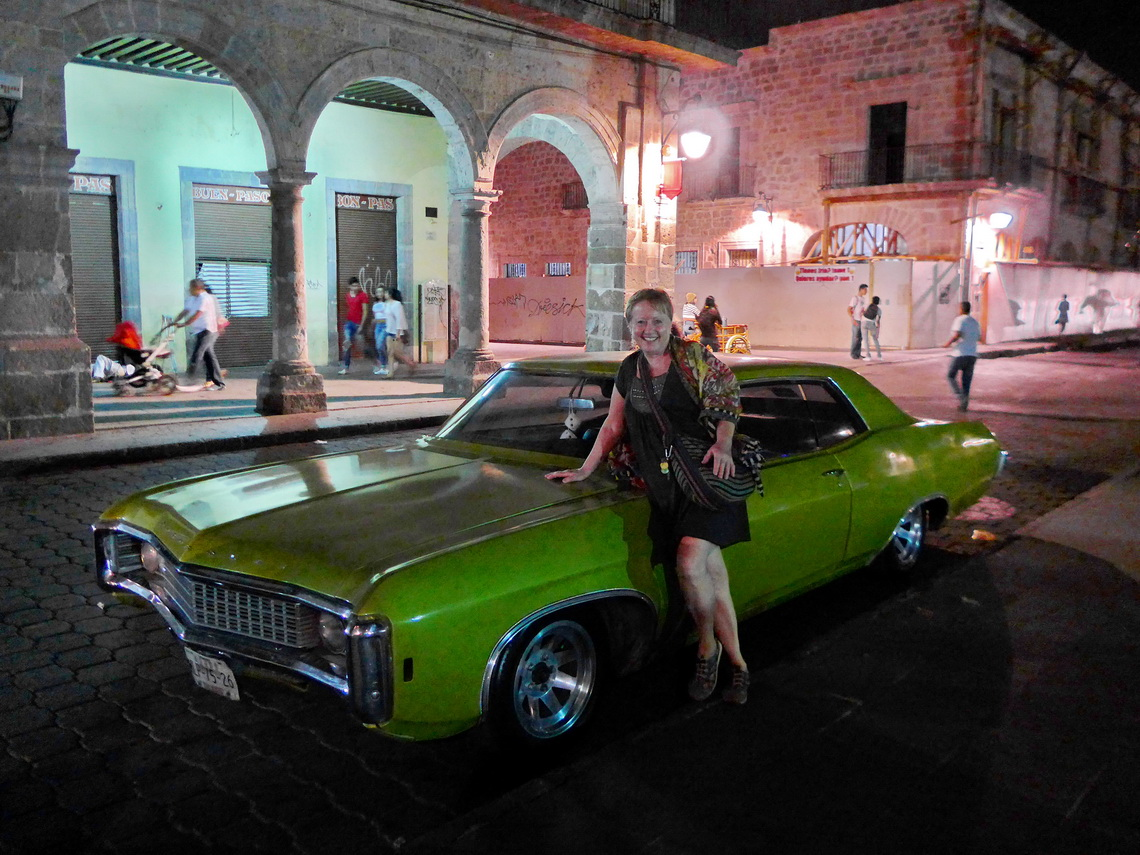 Marion with a fancy car in the old town of Morelia
