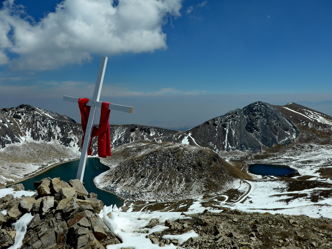 The cross on the eastern peak of Xinantecatl with Laguna del Sol and Laguna de la Luna