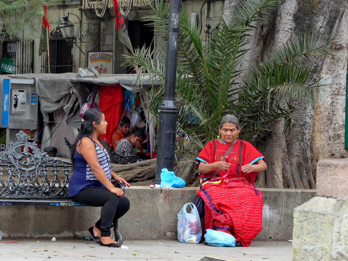 Chatting women on Oaxaca's Zocalo