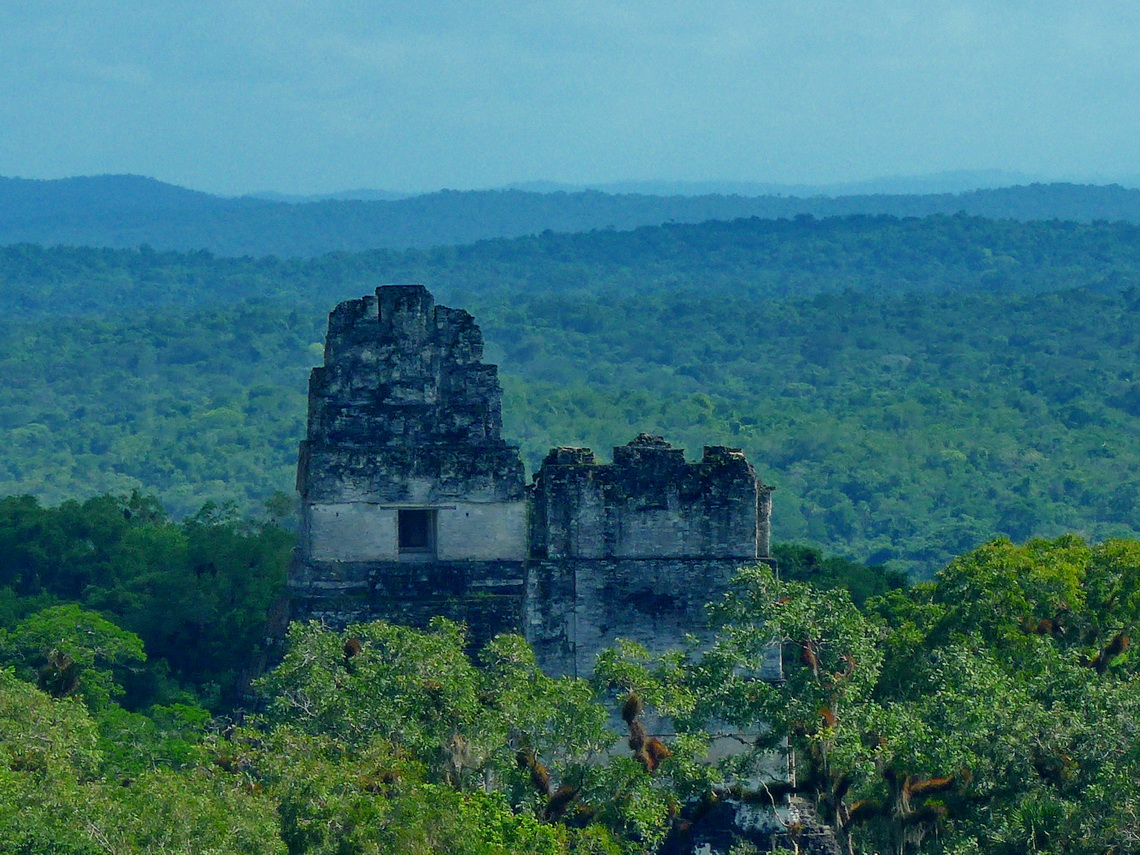 Temple of the Great Jaguar - one of the very steep pyramids of Tikal and its most spectacular (left)