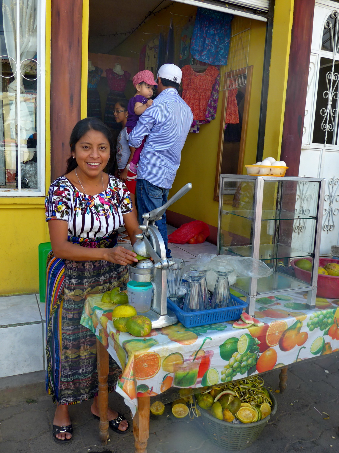 Lady selling fresh orange juice in San Juan la Laguna