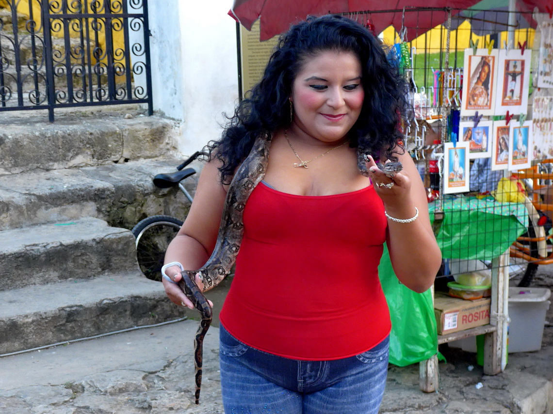Girl with a snake in front of the monastery