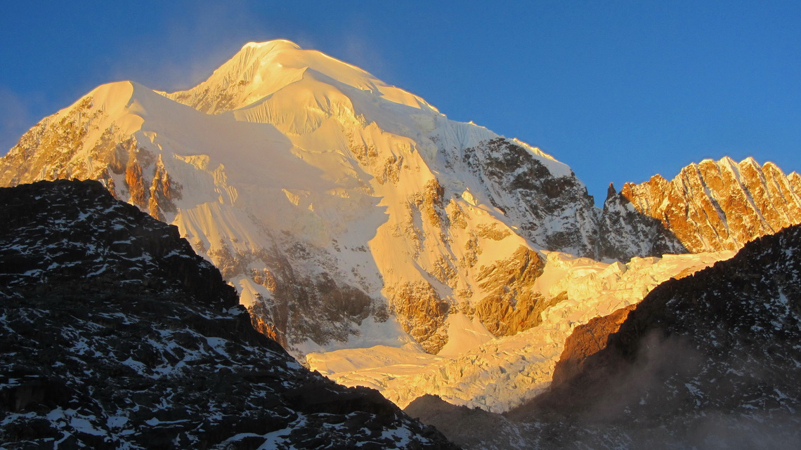 Majestic 6368 meters high Illampu at sunset, seen from Laguna Glaciar