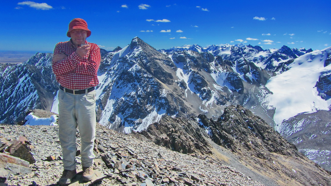 Tommy on the summit of Cerro Austria with the northern part of Cordillera Real in the background