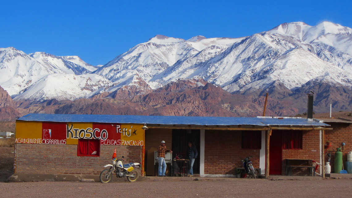 Argentine kiosk on the roadblock with snowy Andes