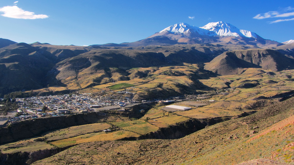 The village of Putre (3600 meters high) with majestic mountains Nevado Putre (approx. 5800 meters)