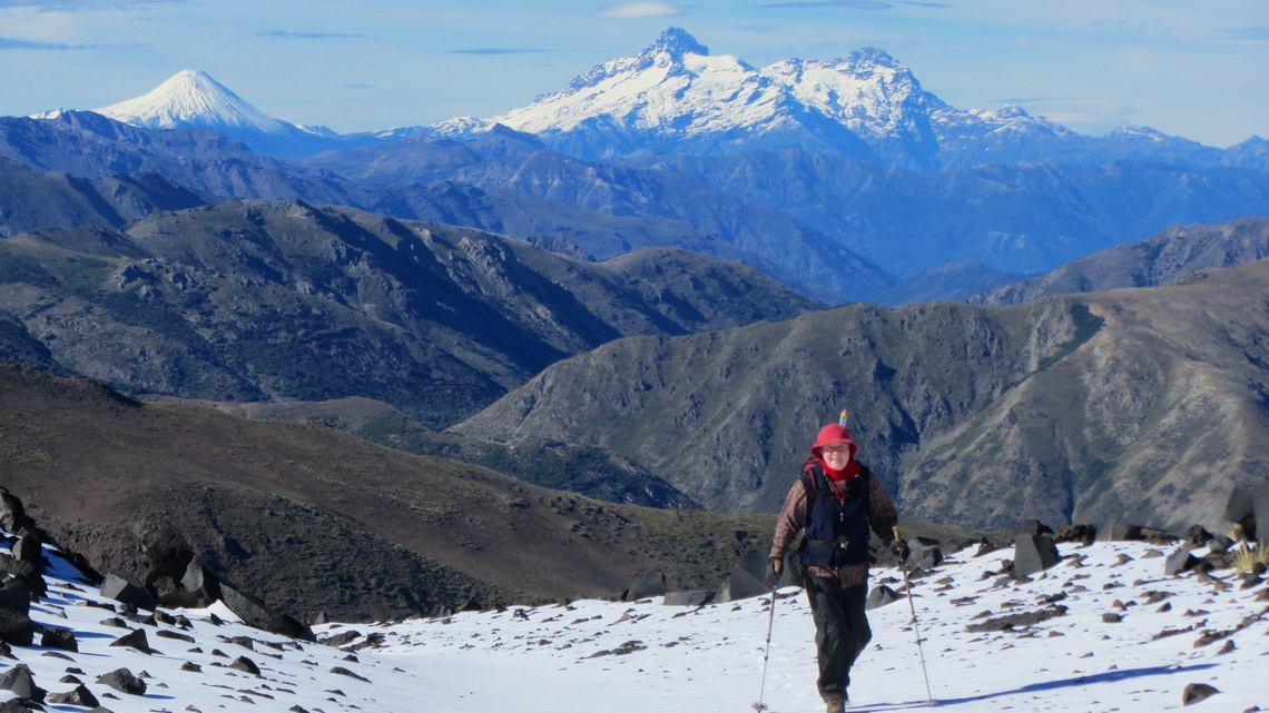 Marion on the way to the summit of Volcan Chillan. Volcan Antuco and Sierra Velluda in the background