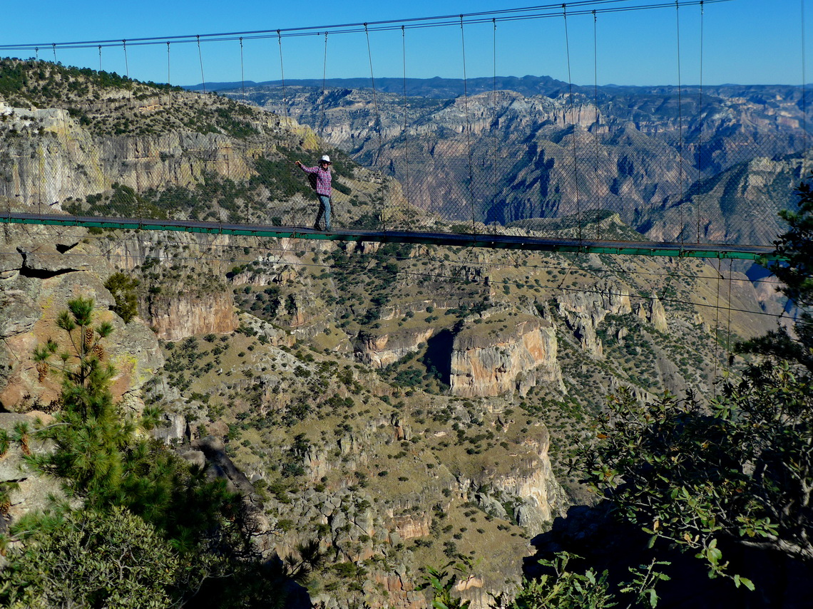 Marion on a suspension bridge with the main canyon in the background