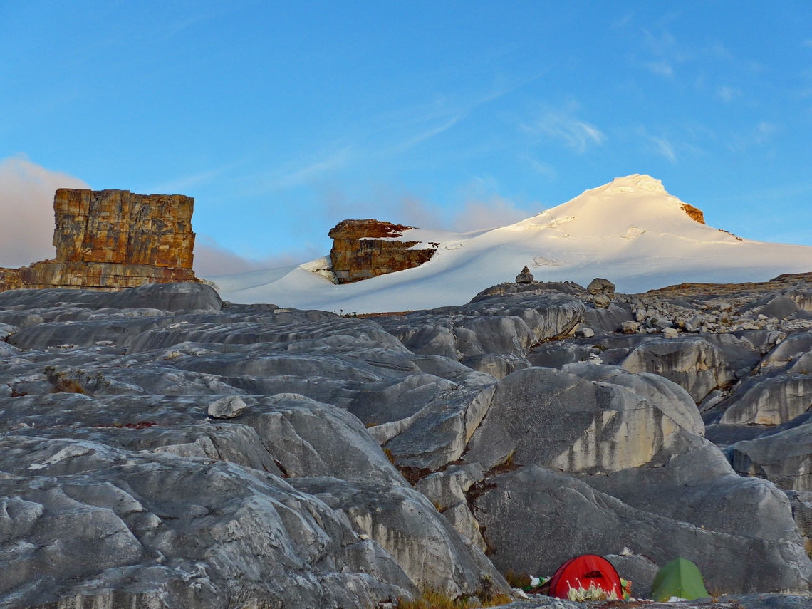 Our high camp with rectangular Púlpito del Diablo and white Pan de Azucar at sunset